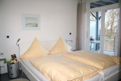 Schlafzimmer der Ferienwohnung 08 in der Villa Wagenknecht