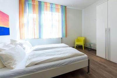 Schlafzimmer der Ferienwohnung 03 in der Villa Höger