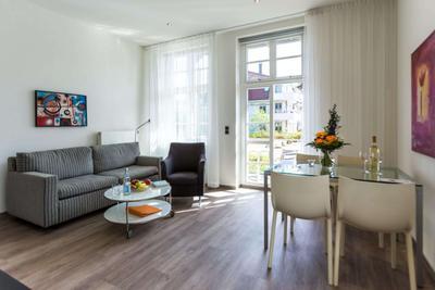 Wohnzimmer der Ferienwohnung 03 in der Villa Höger