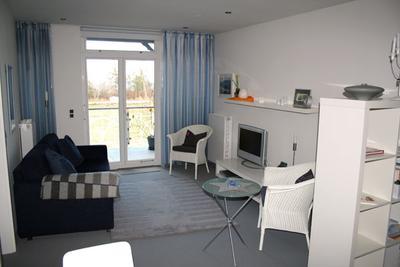Wohnzimmer der Ferienwohnung 08 in der Villa Wagenknecht